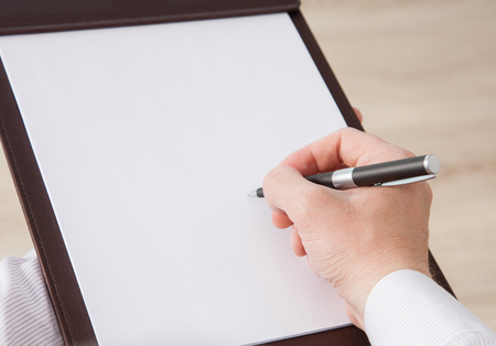 informal: Unrecognizable businessman signing a contract in informal atmosphere Stock Photo