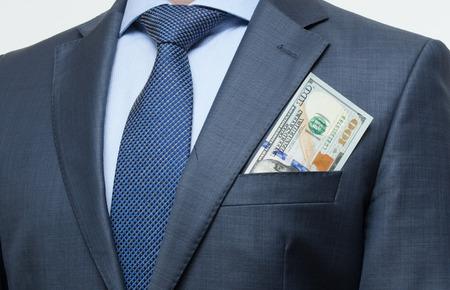 breast pocket: Money in the breast pocket - closeup shot