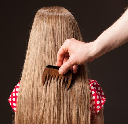 combed: Male hand combing beautiful long hair, closeup shot