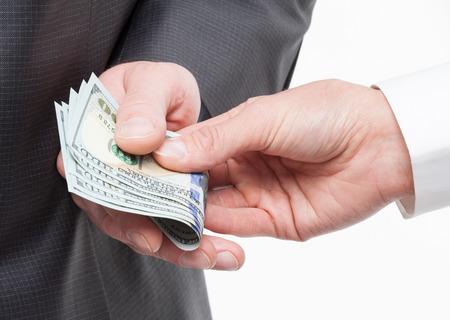 Female hand giving a bribe to businessman - closeup shot
