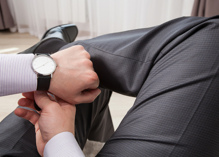 wristlet: Gentleman clasping a wristlet and sitting in the room, closeup shot
