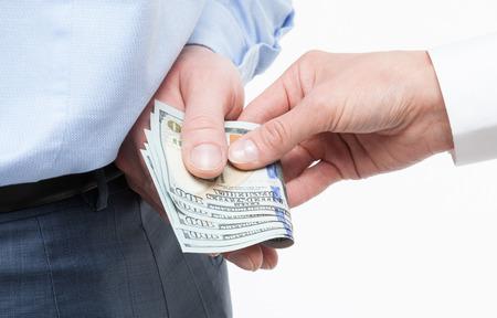 venal: Giving a bribe,  closeup shot