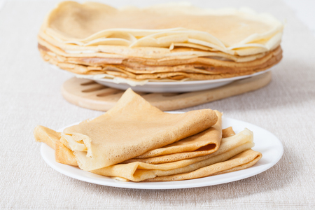 rubicund: Pancakes on plates, neutral background
