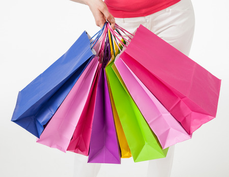 white pants: Young woman in white pants with shopping bags, white background