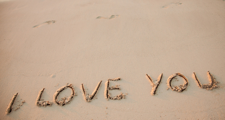 love declaration: Declaration of love: I love you drawn on sand