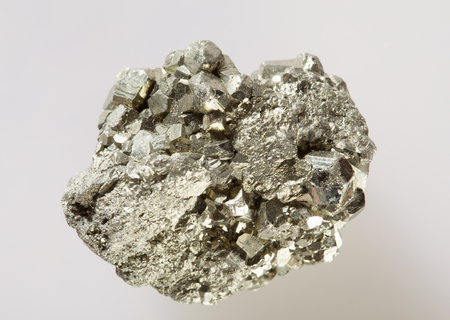 inclusions: Pyrite on gray background Stock Photo