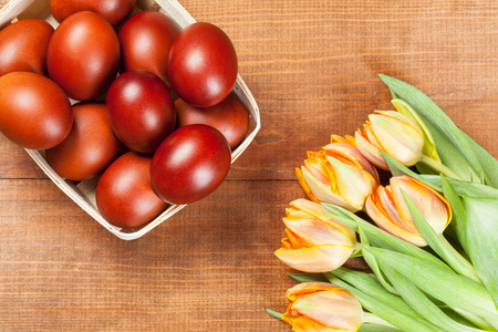 paschal: Paschal eggs in the basket and fresh tulips, closeup shot