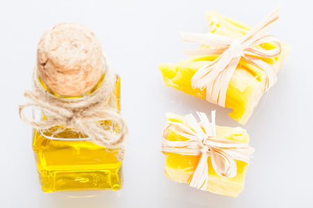 bee balm: Beautiful composition of decorated beeswax pieces and a bottle of olive oil Stock Photo