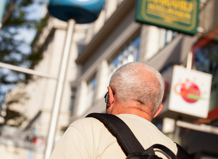 Unrecognizable tourist walking in the street - back view photo