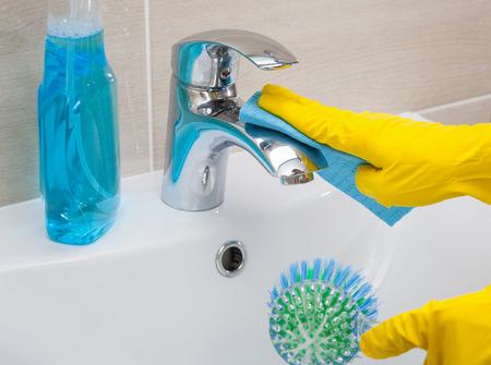 housemaid: Housemaid cleaning a bathroom, closeup shot