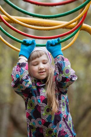 Preschooler girl playing on the playground - closeup shot