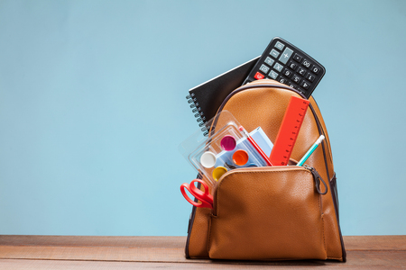 clerical: Backpack with clerical accessories, blue background