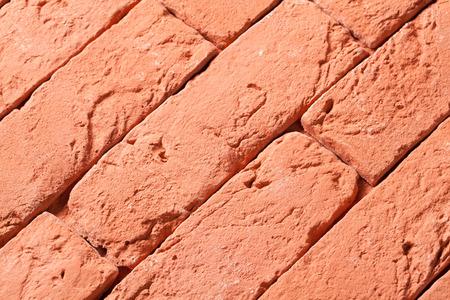 Red fire-bricks lying in a row - closeup shot