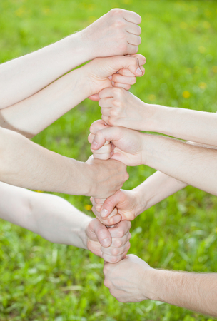 Hands group on summer green  background