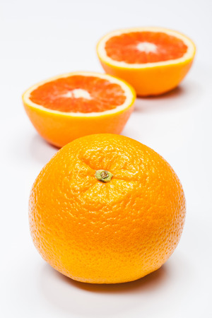 Ripe oranges on neutral background