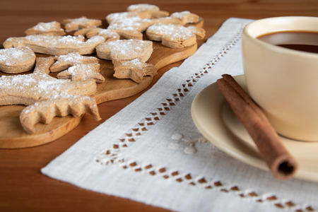 Cup of hot chocolate and homemade ginger cookies on wooden table Stock fotó