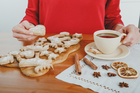 Unrecognizable woman having hot chocolate with ginger cookies for dessert Stock fotó