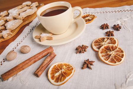 Cup of hot chocolate and homemade ginger cookies on linen tablecloth Stock fotó
