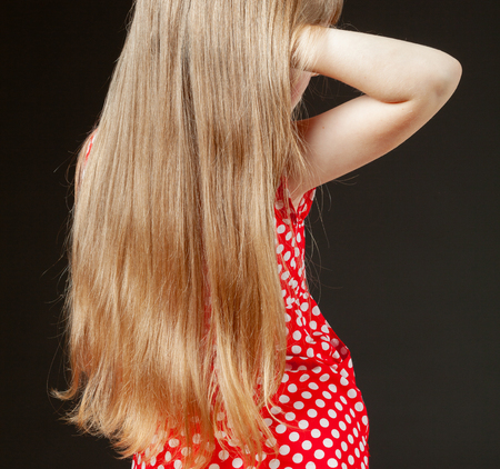 Portrait of little girl with beautiful long hair, black background Stock fotó