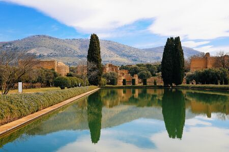 Scenery view of the italian mountains from the Villa Adriana or Hadrian s Villa archaeological site in Tivoli - Rome province- Lazio. The pond is in foreground region- Italy