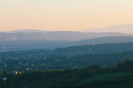 Beautiful sunset with the view of the skyline over the hills around Vienna