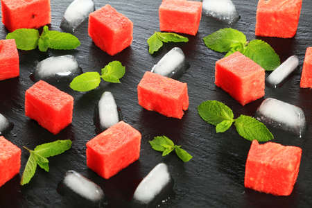Watermelon pieces with mint leaves and ice: Fresh and juicy concept