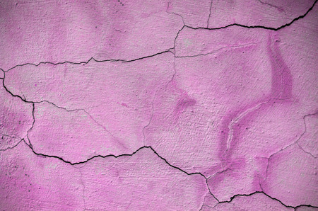 cracked wall: Pink cracked wall Stock Photo