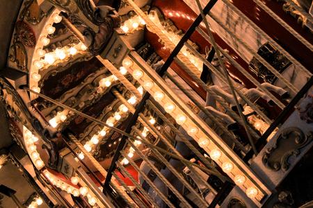 Evening illumination of merry-go-around by bulbs