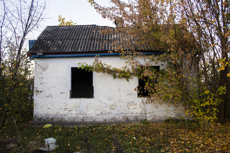 The tumbledown neglected house is in a village 写真素材