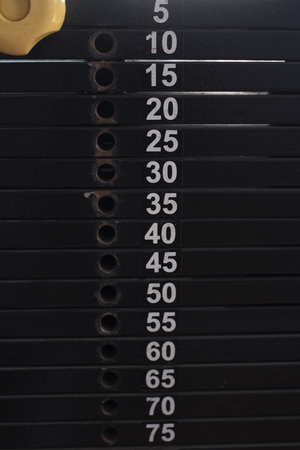 Typesetting loads of sporting trainer with denotation of weight 스톡 콘텐츠