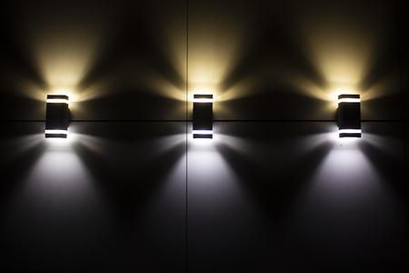 Night street lamps are illuminative a wall