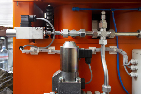 A pipeline of the hydraulic system is high-pressure with the valves of hydrohammer Archivio Fotografico