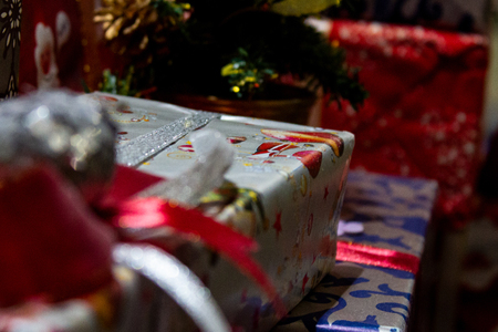Festive christmas gifts are colourfully packed in a varicoloured paper