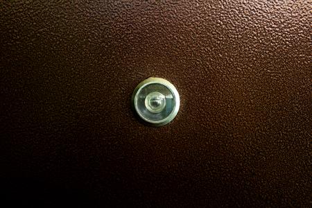 a lens of eyepiece of glass peep-hole is in a ferrous door Stok Fotoğraf