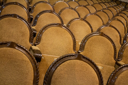 brown rows of arm-chairs of visual hall of theatre
