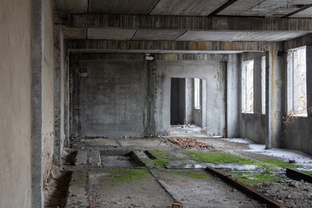 Neglected ruins of unfinished corps of building of plant 免版税图像