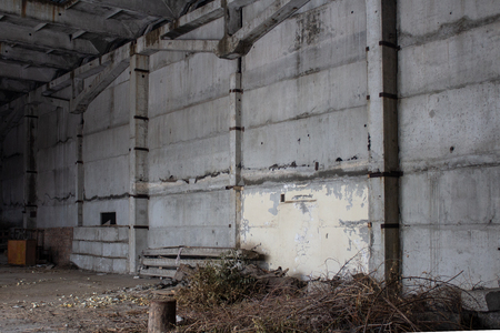 Neglected ruins of unfinished corps of building of plant 写真素材