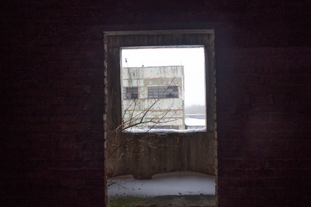 Neglected ruins of unfinished corps of building of plant Imagens