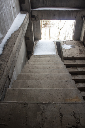 Stair on ruins of the neglected unfinished building 스톡 콘텐츠 - 119832084