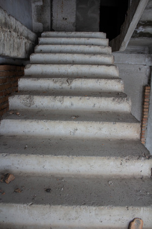 Stair on ruins of the neglected unfinished building Stock Photo