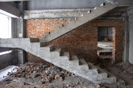 Stair on ruins of the neglected unfinished building 스톡 콘텐츠