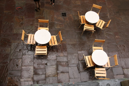 Top view shot of tables and chairs in a cafe. photo