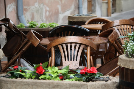 wooden cafe table and chairs after rain photo