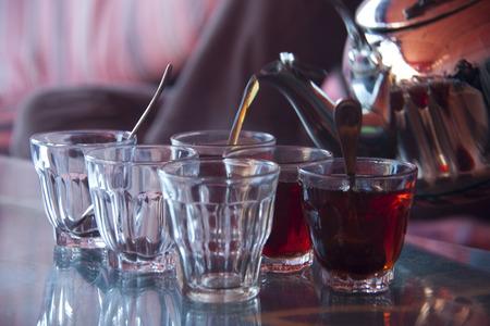 nana: Set of arabic nana mint tea with metal tea pot and glasses  Stock Photo