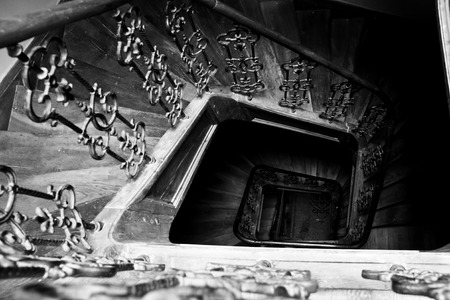 beautiful black and white image of staircase in old building photo