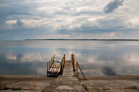 dusky: old wooden pier at a lake