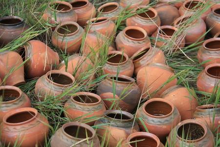decorative clay vase in garden photo
