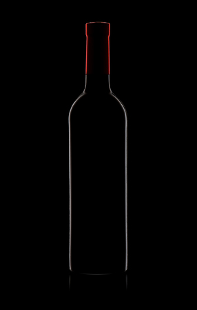 Silhouette of red wine bottle on black background