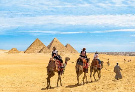Camel riding near the Great Pyramids in Giza, Egypt