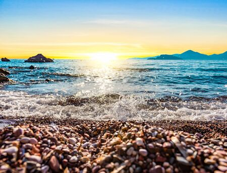 Pebble beach on Adriatic sea at sunset, Montenegro